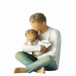 figurine of man holding a baby